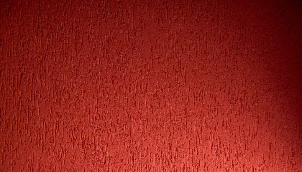 Although red is a stimulating colour, it adorns the walls of many bedrooms.