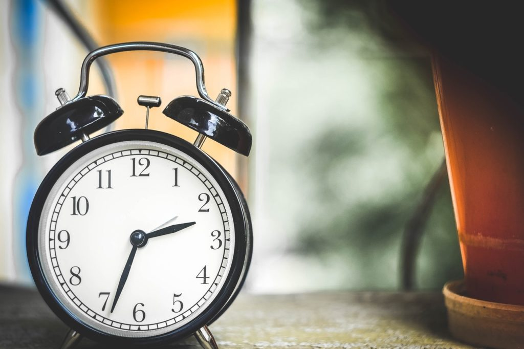 An alarm to wake you and one to tell you when to get to bed can make getting up earlier a little easier.