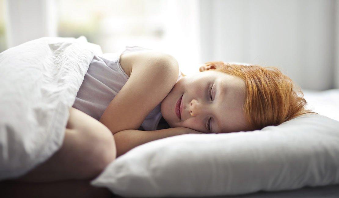girl sleepig, smiling