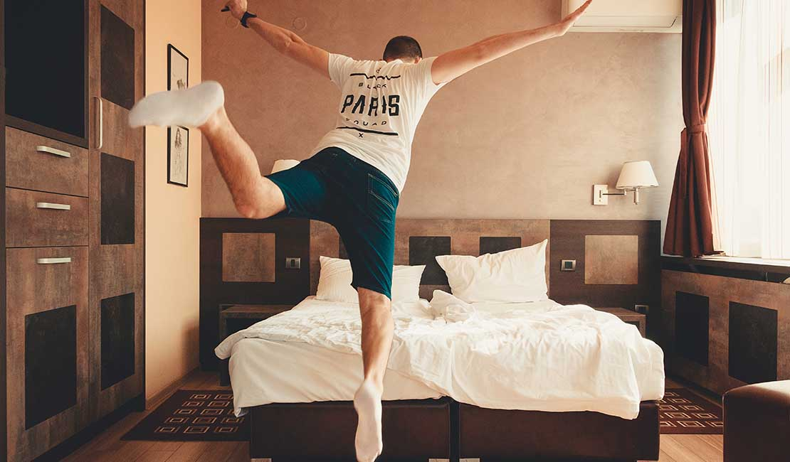 jumping onto a bed