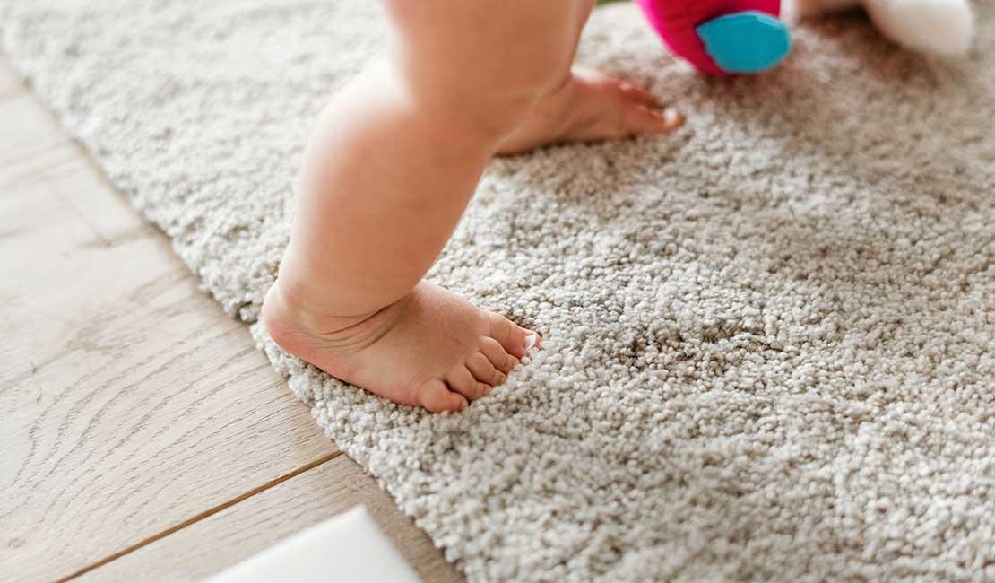 Baby feet on rug
