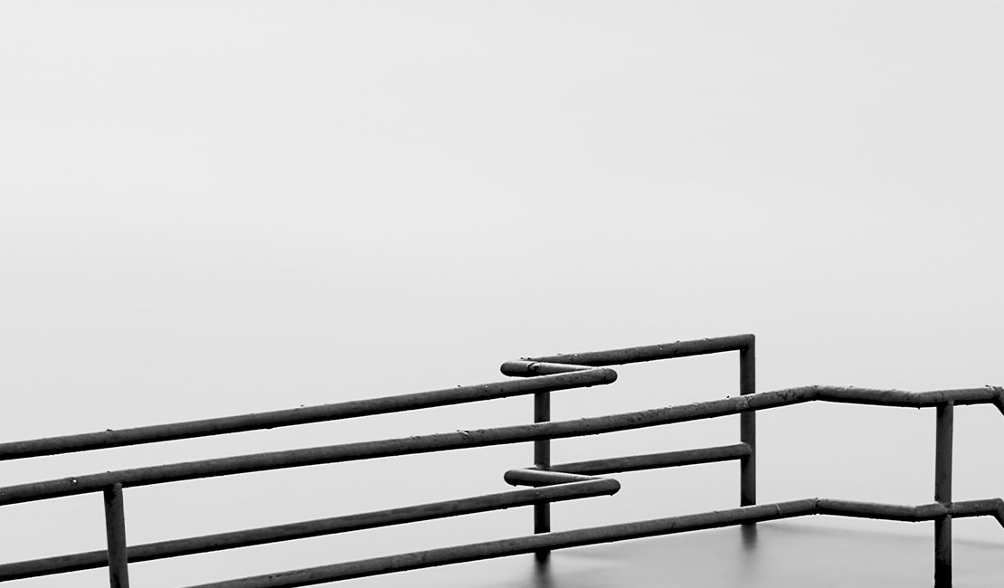 Steel railing against a white background.