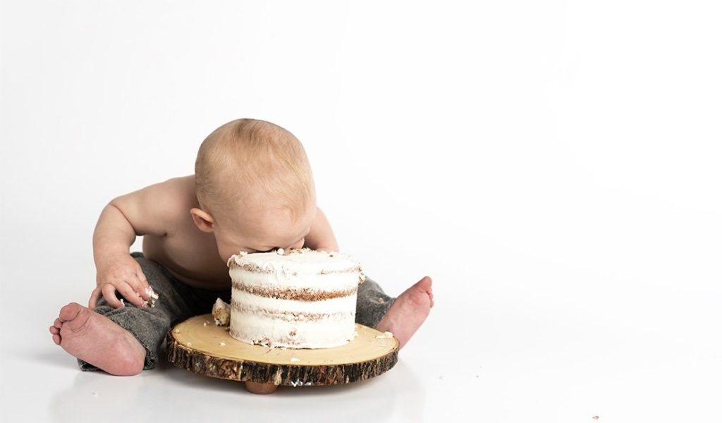 Baby eating a cake