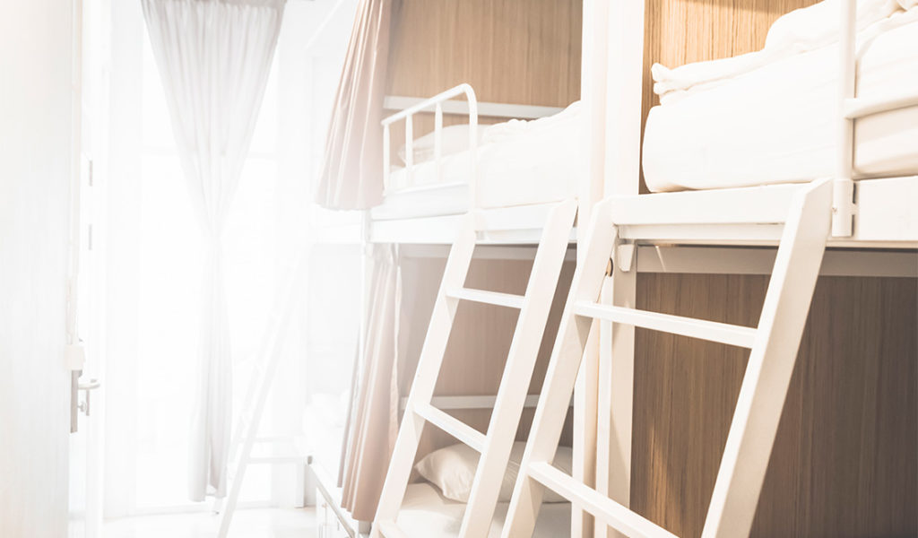 view of white painted bunk bed ladder