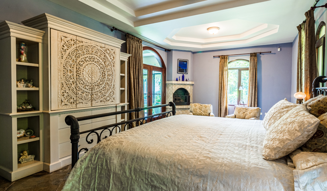 A luxuriously furnished room with cream coloured bedding.