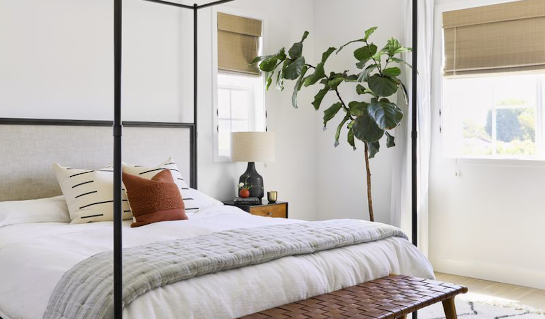 Bohemian/modern bedroom with clean lines and plants to give the bedroom a natural feel.