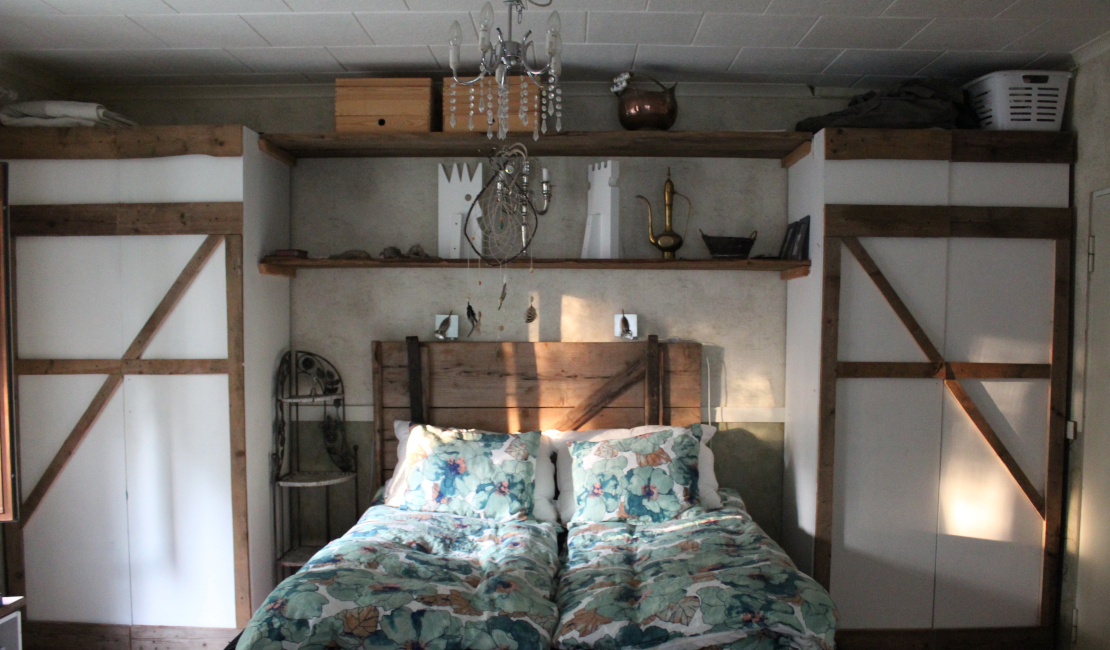 Wooden DIY headboards go well in a rustic or farmhouse themed bedroom.