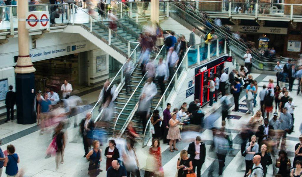 Long exposure photo taken of people walking in a mall.