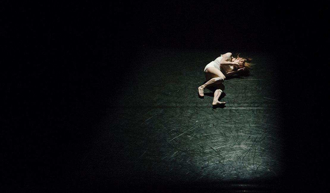 girl lying in a dark room